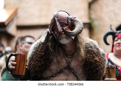 Crownsville, MD - October 14, 2017: A man dressed in medieval attire at the Maryland Renaissance Festival, an annual event representing a fictional 16th-century English village named Revel Grove.
