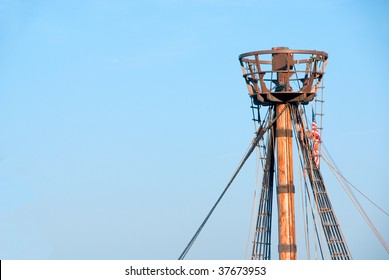 A crows nest on a replica of a historical ship.