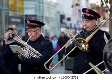 CROYDON, UK - DECEMBER 10, 2011: A tuba player and a trombonist in the Salvation Army brass band perform Christmas songs on Croydon's North End shopping street.
