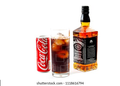 Croydon, UK - June 14, 2018: Illustrative editorial of  a bottle of Jack Daniel's bourbon whiskey next to a can of Coca Cola and a glass of jack and coke isolated on white background
