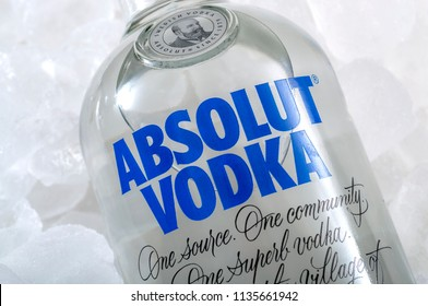 Croydon, UK - June 28, 2018: Illustrative editorial of a bottle of Absolut vodka on pile of frozen ice background
