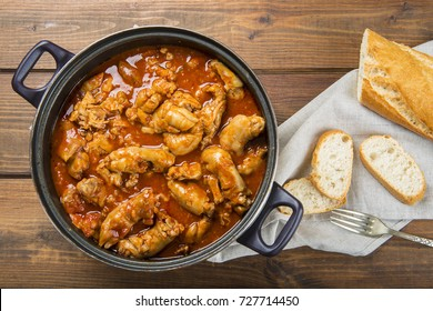 Crubeens with tomato sauce and bread Spanish recipe