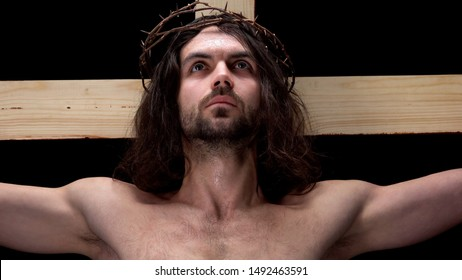 Crucified son of God looking up, religious self-sacrifice, bible history, belief
