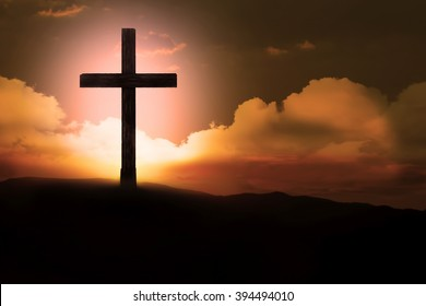 Crucifix with bright sun