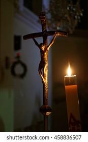 a crucifix in candle light