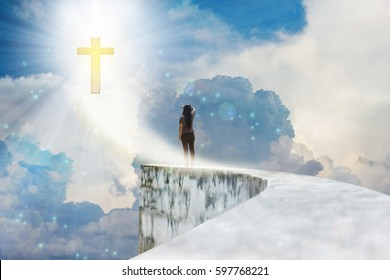 Crucifix or cross on heaven cloudy sky with lens flare and backside or rare view of women or girl on dead end high way footpath or top of wall