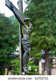 crucifix detail of tourist attractions on the old Salzburg Cemetery, Austria