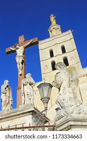 Crucifix in front of The Popes' Palace in Avignon, France