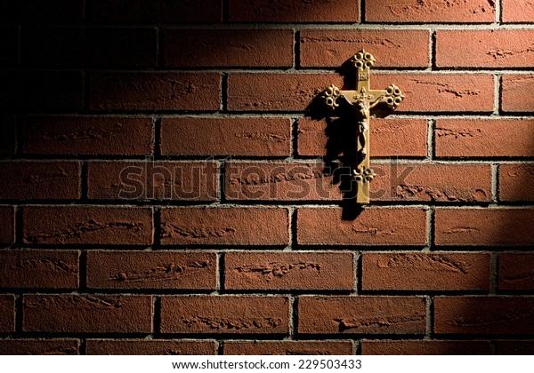 crucifix with Jesus on brick wall