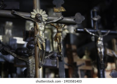Crucifix of Jesus on the cross, on blurred background of group crucifixes. Symbol of religion and Christian faith.