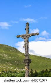 Crucifix on a blue sky background in Lourdes, Pyrenees, France