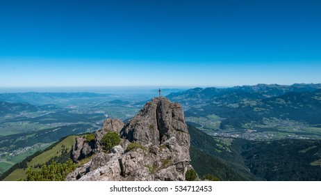 A crucifix on the peak of a mountain in Liechtenstein and Switzerland