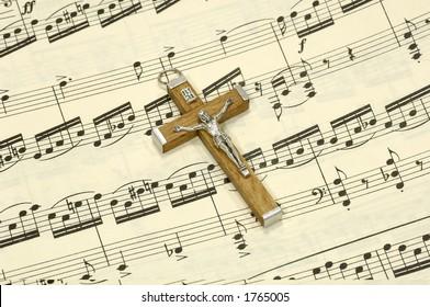 Crucifix on top of Sheet Music