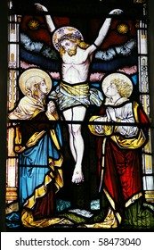 Crucifixion The Crucifixion of Christ depicted in a Victorian stained glass window over 100 years old.  On public display in Saint Mary Magdalene and Saint Denys Church, Midhurst, West Sussex.