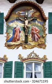 crucifixion Christ on house wall, Bavaria, Germany, village Oberammergau