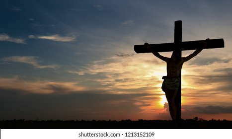 Crucifixion with Jesus against the background of the falling sun.
