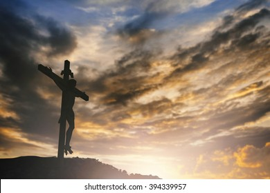 Crucifixion of Jesus christ ascension on cross over sunset concept for good friday christian prayer that god he is risen in easter day, christmas 2017 christianity