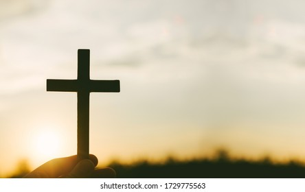 Crucifixion of Jesus christ ,cross with field at sunset.