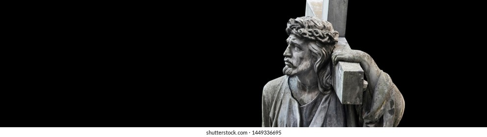 The crucifixion of Jesus Christ  in profile. Antique statue isolated on black background.