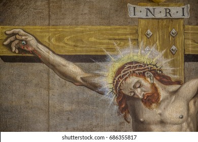 The crucifixion of Jesus. His head with the crown of thorns is bent down. INRI.  an altarpiece  from 1613 by an unknown artist in Jorlunde church, Denmark - July 25, 2017