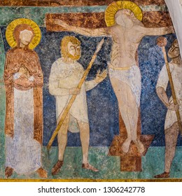The crucifixion, a medieval romanesque fresco with Vigin Mary and Longinus with his spear, Jorlunde church,Slangerup, Denmark, July 24, 2017