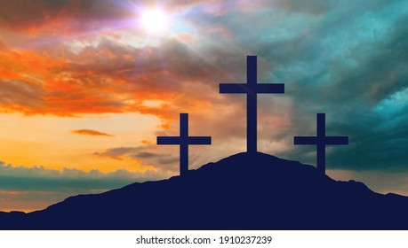 crucifixion, religion and christianity concept - silhouettes of three crosses on calvary hill over sky background