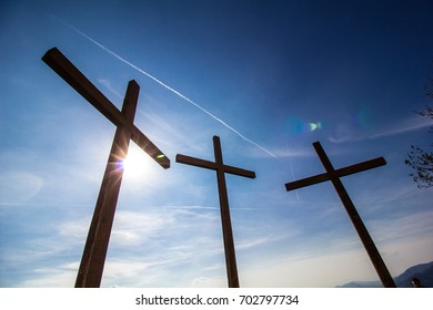 Crucifixion, three crosses against a blue sky.