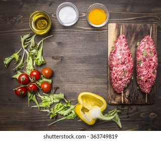 Crude kebab skewers on a chopping board with vegetables and spices on wooden rustic background top view close up place for text,frame