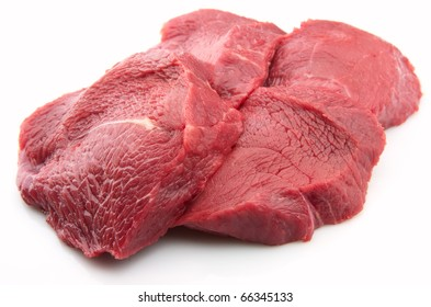 Crude meat closeup on a white backgrounds