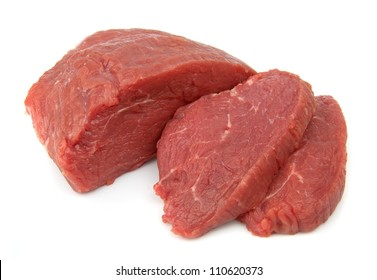 Crude meat on white close up