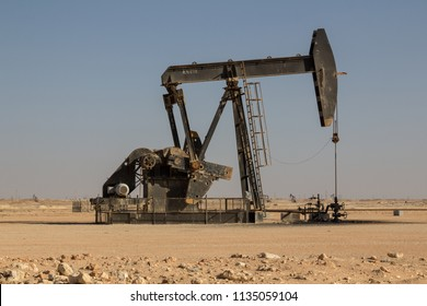 Crude oil drilling well pumping the black gold out of the soil of the Sultanate of Oman in the middle east