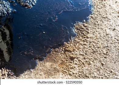 Crude oil spill on sand,Texture of crude oil spill on sand beach from oil spill accident,Effect of oil spill on the beach, pollution,waste management