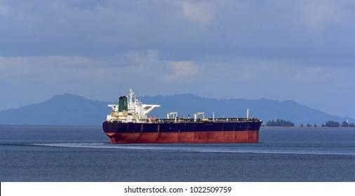 Crude oil tanker in ballast underway in coastal zone near Singapore.