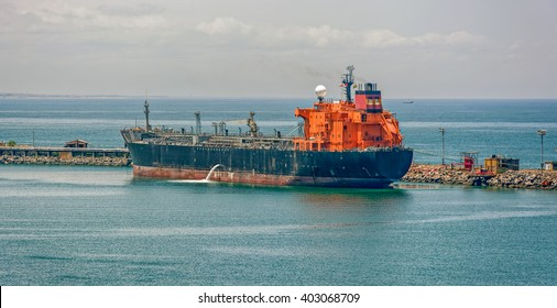 Crude oil tanker pumping ballast water in Lagos, Nigeria, Africa