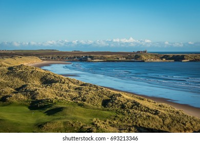 Cruden Bay in Aberdeenshire with Slains Castle in the distance.