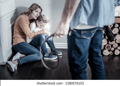 Cruel person. Inadequate drunk man punishing his family while being at home