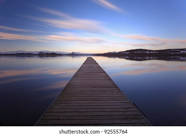 The Cruin jetty and cloud reflections. long exposure. Photographed at Duckbay marina on the west bank shores of Loch Lomond