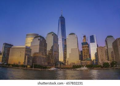 Cruise around Manhattan at sunset - Architectural modern buildings at lower Manhattan - Skyline view at New York City