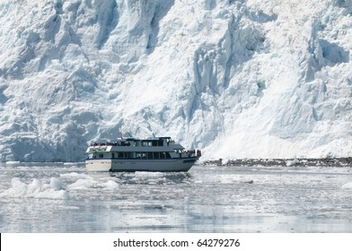 A cruise boat in front of a glacier in Alaska