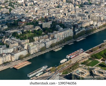 cruise boat on the Seine seen from an helicopter at Paris