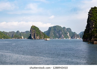 Cruise boats sailing among the karst formations in Halong Bay, Vietnam, in the gulf of Tonkin. Halong Bay is a UNESCO World Heritage Site and the most popular tourist spot in Vietnam