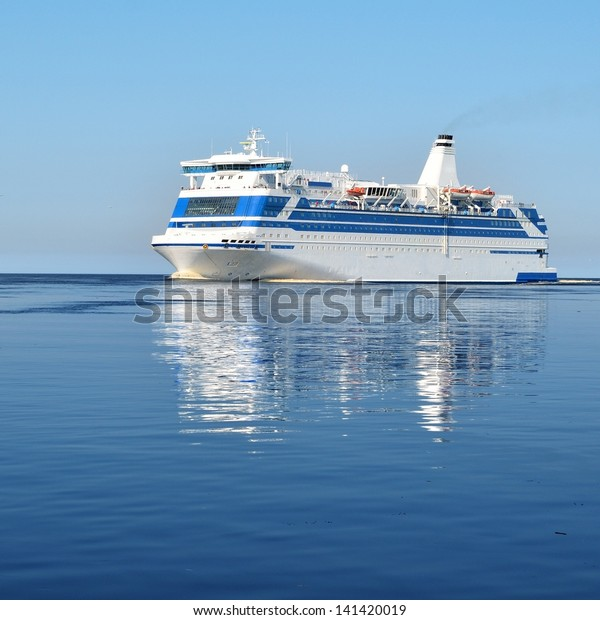 cruise ferry ship sailing in still water