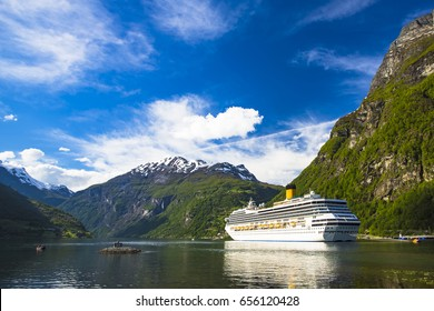 Cruise liner anchored at Geiranger fjord. Geiranger, Norway.
