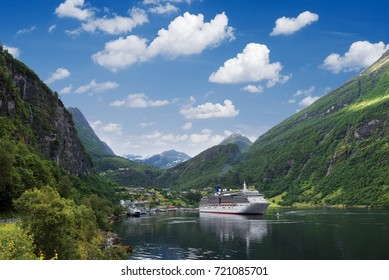 Cruise liner in the fjord. Geirangerfjord and village of Geiranger, Norway