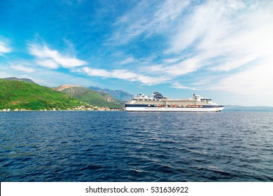 Cruise liner ship swimming at blue adriatic sea, mountains landscape