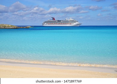 Cruise liner standing on anchor at sea near the  island. Carnival Cruise Lines. Carnival Splendor. Half moon key, Bahamas. July 20, 2019