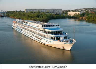 Cruise liner with tourists passes through the Volga-Don Shipping Canal named after Lenin. Volgograd. Russia