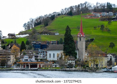 Cruise on Lake Lucerne in atutumn - Village on the lakeside and Church, Central Switzerland, Switzerland