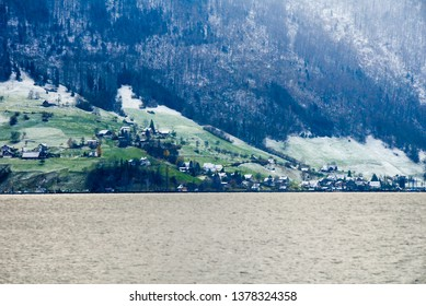 Cruise on Lake Lucerne - Scenery of lakeside with thin snow in atutumn, Central Switzerland, Switzerland