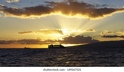 Cruise ship against sunset on Ocean in Hawaii